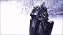 Wraith Reveal | horrific hooded figure in snow - stock footage