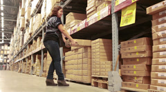 Man helping the woman to bring some heavy goods from shop shelves Stock Footage