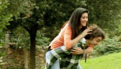 Boyfriend and girlfriend fighting happy in park - stock footage