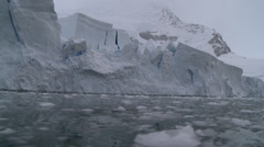 Towering ice cliff with brash ice to fore, Antarctica Stock Footage