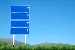 signpost and blue sky - stock photo