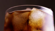 Stock Video Footage of Close up view of the ice cubes in cola background