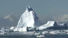 Beautiful blue berg amidst sea ice, Antarctica Stock Footage