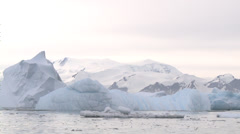 Iceberg rolling over, Antarctica - stock footage