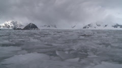 Low water shot from a small boat passing through  broken sea ice, Antarctica Stock Footage