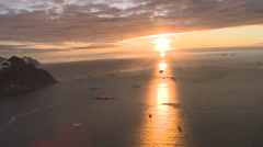 Sunset lights up Antarctic sea. Aerial Stock Footage