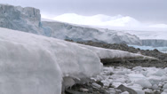 Stock Video Footage of Ice flow on rocky beach, Antarctica