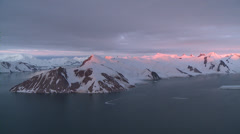 Rose-tinted sunset on Antarctic Mountains. Aerial Stock Footage