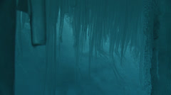 Shimmering blue icicles in crevasse, Antarctica Stock Footage