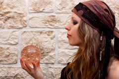 side view of a female fortune teller - stock photo