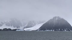 A cold wind whips across a freezing Antarctic sea Stock Footage