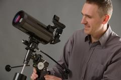 Man with telescope Stock Photos
