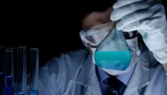 Chemist Mixing Liquid Mixing Flask Observation Experiment Stock Footage