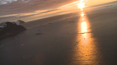 Sun set, beautiful light Antarctic sea dotted with glowing bergs - stock footage