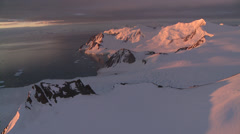 Aerial sunset Antarctic Mountains Stock Footage