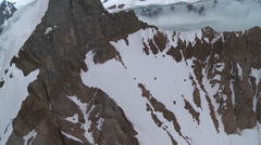 Flying very close to mountain peak, Antarctica - stock footage