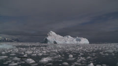 Large berg in brash ice, Antarctica Stock Footage