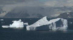 Bergs in the sun, blue, Antarctica Stock Footage