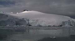 Glacier enter sea. Moody sky, Antarctica Stock Footage