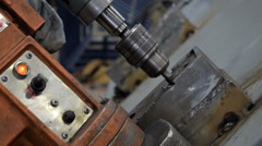Industrial drill working on a metal piece, close up Stock Footage