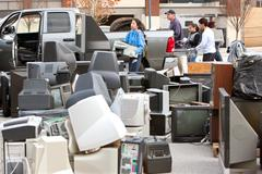 Discarded electronics pile up at county recycling event Stock Photos