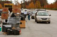 Stock Photo of county residents drop off items for recycling event
