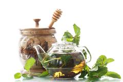 Tea with honey and mint Stock Photos