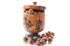 hazelnut brown in wooden pot - stock photo