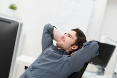businessman sitting daydreaming - stock photo