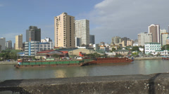 View from fort santiago of pasig river skyline manila philippines Stock Footage