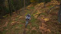 AERIAL: Downhill biker Stock Footage