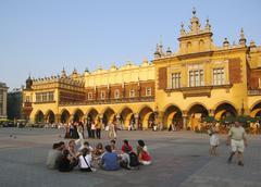 krakow poland, tourists cloth hall ( sukiennice ) main market square ( rynek - stock photo