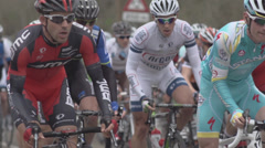 Stock Video Footage of Cyclists Passing By in Slow Motion