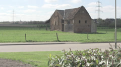 Car Passes By Old Farm House Stock Footage