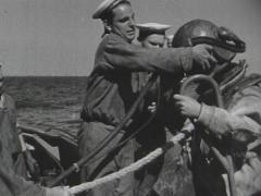 Stock Video Footage of sailors putting vintage diving helmet on diver