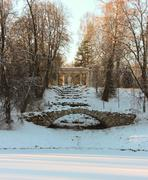 view with hump bridge and apollo colonade in pavlovsky park on january 2014 - stock photo