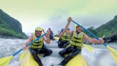 Group of senior people having fun on whitewater rafting trip - stock footage