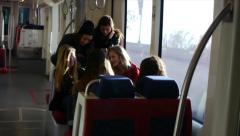 Six Teen Girls Having Fun Traveling On A Light Rail Train Stock Footage