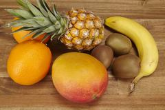 multivitamin - pineapple, oranges, banana, kiwi and mango - stock photo