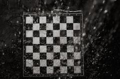 chessboard under the rain - stock photo
