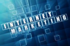internet marketing in blue glass blocks - stock illustration