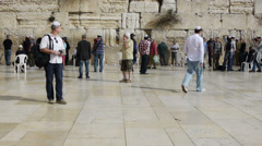 Many tourists and true believers near Western Wall, Jerusalem Stock Footage