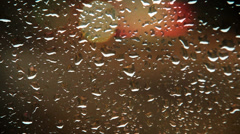 Rainy water drops on the car glass evening traffic view Stock Footage