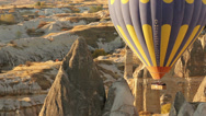 Stock Video Footage of Colorful hot air balloons flying over valleys in Goreme, Cappadocia, Turkey.