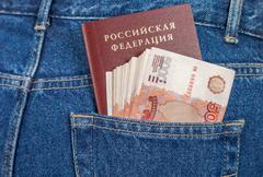 Russian rouble bills and passport in the back jeans pocket Stock Photos