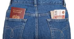 russian rouble bills and passport in the back jeans pocket - stock photo