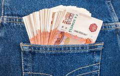russian rouble bills in the back jeans pocket - stock photo