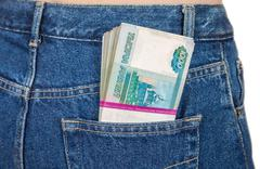 stack of russian rouble bills in the back jeans pocket - stock photo