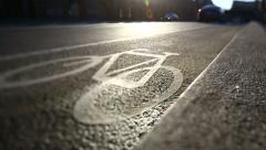 Backlit shot of cycle track in the sunset. - stock footage