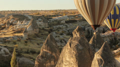 Colorful hot air balloons flying over valleys in Goreme, Cappadocia, Turkey. Stock Footage